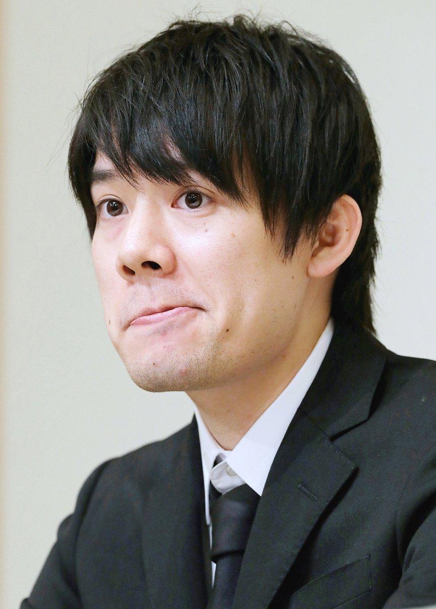 記者会見で厳しい表情を見せる仮想通貨交換業者コインチェックの和田晃一良社長(8日、時事)
